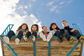 Free Company Of Five Young People Sitting Together Royalty Free Stock Photo - 11659815