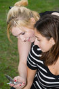 Free Friends On Cell Phone Together (Beautiful Young Blonde And Brune Stock Images - 1323214