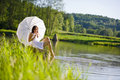 Free Spring - Happy Romantic Woman Sitting By Lake Royalty Free Stock Photos - 14667848