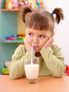 Free Gloomy Little Girl Drinks Milk Stock Image - 15972201