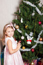 Free Lovely Preschool Girl Decorating Christmas Tree Stock Image - 17270051