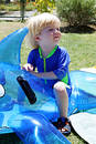 Free Young Boy Or Child Sitting On Inflatable Dolphin By Swimming Pool Royalty Free Stock Photo - 217625