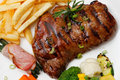 Free Garnished Plate Of Grilled Steak Meat Royalty Free Stock Image - 22454686