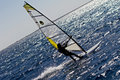 Free Silhouette Of A Windsurfer Royalty Free Stock Image - 23077156