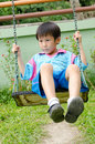 Free Asian Boy Playing Swing Outdoor Royalty Free Stock Images - 23202849