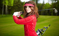 Free Woman Playing Golf On A Green Woman Stock Images - 23443934