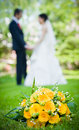 Free Newly-married Couple And Wedding Bouquet In The Fo Stock Photo - 24704550
