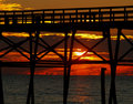 Free Sunset Gleaming Through Pier Royalty Free Stock Photos - 2542118