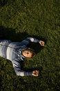 Free Man Lying On A Lawn Royalty Free Stock Image - 2607626