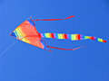 Free Colorful, Colorful, Striped Kite Flying In The Blue Sky Stock Photo - 28533930