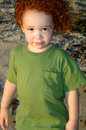 Free Curly Red-haired Boy At Beach Royalty Free Stock Photos - 3263468