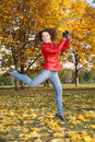 Free Girl In Red Jacket Jumps In Park Royalty Free Stock Photos - 3907148