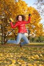 Free Girl In Red Jacket Jumps In Park Stock Photo - 3907150
