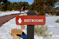 Free Sign Pointing To Restrooms Stock Image - 4235051