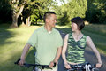 Free Couple ] Standing Next To Bicycles - Horizontal Royalty Free Stock Photography - 5899577