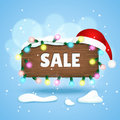 Free Wooden Sign With Sale Text, Christmas Lights And Christmas Hat Royalty Free Stock Images - 61708619
