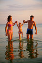 Free Parents Hold Daughter For Hands In Sea Royalty Free Stock Photography - 6582437