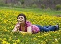 Free Young Woman Lying In A Meadow Stock Photography - 9065022