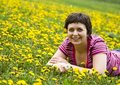 Free Young Woman Lying In A Meadow Stock Image - 9065071