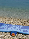 Free Sea And Sun Creme And Towel Do Not Disturb Stock Photography - 9569662
