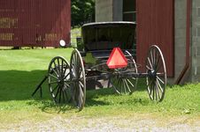 Amish Wagon By Barn Stock Photo