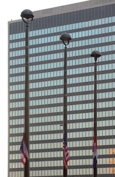 Three Flagpoles And Office Building Stock Photos