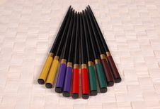 Multi Colored Chop Sticks On Mat Stock Photography