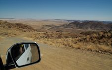 Free Car Mirror And Great Desert Landscape Royalty Free Stock Photography - 1005137