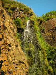 Cliff Top Waterfall Portrait Royalty Free Stock Images