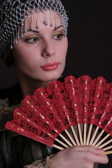 Free Decadanse With A Red Fan Stock Photo - 1007420
