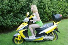 Free Beautiful Woman On Motor Scooter Stock Photos - 1009683