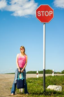 Young Woman And Stop Sign Stock Photography