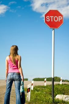 Young Woman And Stop Sign Royalty Free Stock Photo