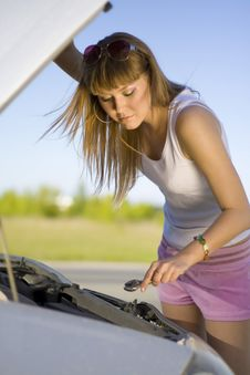 Free Girl Looking Under The Car Royalty Free Stock Image - 10002286