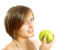 Free Attractive Girl Holding A Green Apple Stock Photography - 10002792
