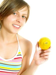 Free Very Cute Lady Showing A Lemon Stock Photography - 10002832