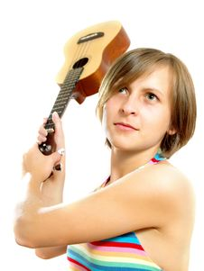 Attractive Girl Fighting With A Guitar Royalty Free Stock Images