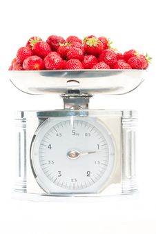Free Strawberry In The Scale Royalty Free Stock Photo - 10003795