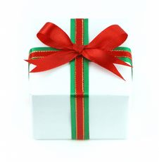 White Gift Box With Red And Green Ribbon Royalty Free Stock Photography