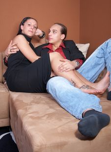 Free Stylish Couple On A Couch Stock Photography - 10006602
