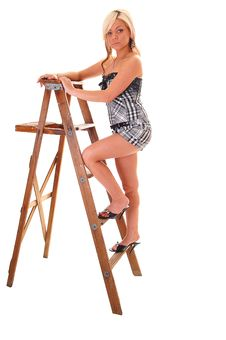 Girl On Stepladder. Royalty Free Stock Image