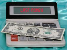 Calculator And Two Dollars Royalty Free Stock Photos