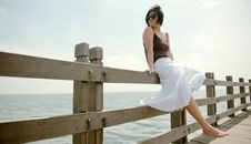 Free Girl Sits On Railing Royalty Free Stock Photography - 10015857