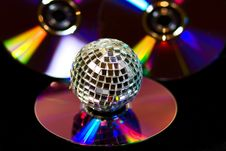 Disco Ball With Music DVDS On Black Stock Image