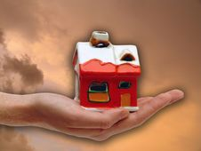 Free The Red House In The Human Hand Stock Photography - 10017472