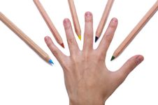 Free Colorful Pencils Around A Hand Royalty Free Stock Photos - 10017818
