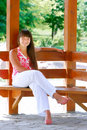 Free Girl Sitting On Wooden Bench In Park Royalty Free Stock Photo - 10027155