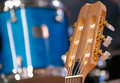 Free Headstock Of Guitar Against Drum. Royalty Free Stock Photography - 10027527