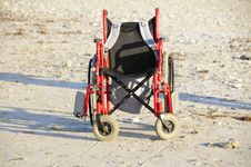 Free Wheelchair On The Sand Stock Image - 10020671