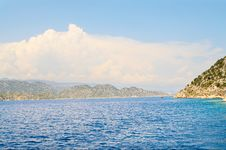 White Clouds Above Mountains And Sea. Stock Image